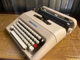 Vintage portable Olivetti typewriter - retro style with original carry case