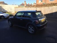Mini Cooper 2007 New shape in black ,drives well ,6 speed ,read all ad px welcome