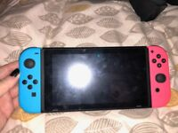 Nintendo switch blue/red - inbox accessories and 2 year warranty and no games