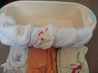 Baby bath and towels, some of the towels have mitts with them
