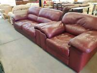 Red leather two seater sofa with matching chair