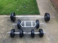 FULL WEIGHTS SET WITH BARBELL, TRICEP BAR AND SET OF DUMBELLS WITH 128KG OF CAST IRON WEIGHTS