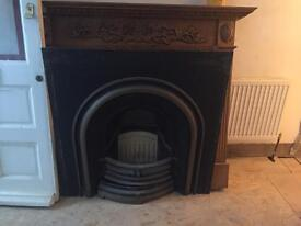 Fireplace and carved wood surround