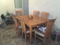 Light oak table and six chairs with cream seating