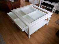 Glass top white coffee table