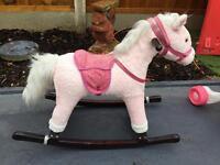 Kids rocking horse in pink