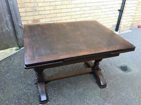 Extendable antique table