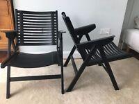 Pair of black REX folding designer lounge chairs