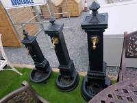 Cast iron garden water taps and pumps pots and urns