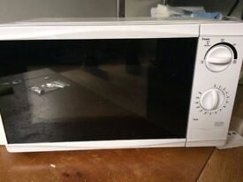 Nearly new microwave in original box