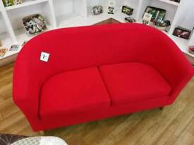 Red fabric tub sofa with wooden legs