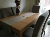 Light oak extendable dining table and 6 upholstered chairs