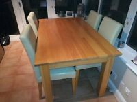Light Oak dining table & 4 cream faux leather chairs. Excellent condition.