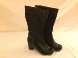 Clarks black boots. New. Size 4
