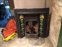 Cast iron tiled fireplace, grate and 4 piece toolset for sale