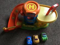 Car garage toy complete with 3 cara
