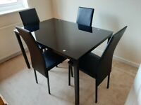 Black Glass Dining Table and Set of 4 High-Back Black Chairs
