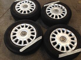 vauxhall astra set 4 wheels and tyres with hub cap