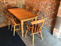 Solid oak table and 6 chairs (2 carver chairs)