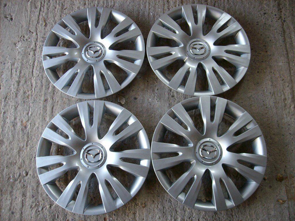 "full set of original mazda 2 wheel trims 15"" | in southport"