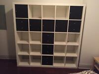 Basically new modern wall size shelving unit. Excellent storage!