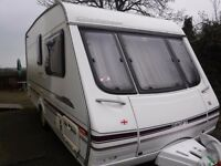 Swift Challenger480SE caravan, including porch awning (which hasnt been used much), Microwave, etc