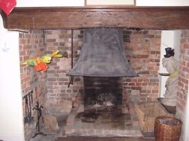 Antique large iron hood for open-fire fireplace grate