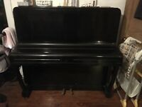 Upright piano. Black.