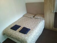 Room in front of DLR station. Double bed, 2 people living.