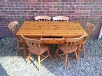 Solid pine dining table with drawer. Plus 6 Chairs
