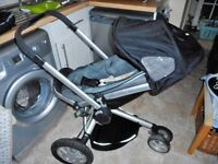 charcoal grey quinny buzz stroller with warm cosy toes