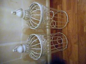 two bird cage candle holders