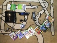 Xbox 360 with Kinect Sensor and 8 games and accessories (check pictures)