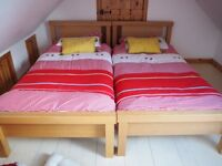 2 single wooden beds with mattresses in excellent condition