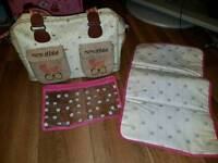 Yummy mummy pink lining changing bag.