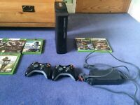 XBox 360 Elite,12 games and two controllers ( Only 2 games = £70)