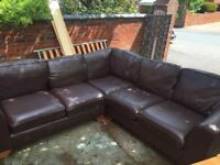 Large brown leather L shaped sofa