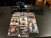 PS3 games console complete with 15 games, controllers and headphones