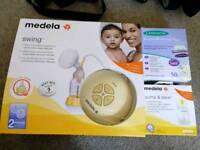 Medela swing electric 2-phase breast pump and breastmilk storage bags