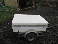 Small car trailer with lid
