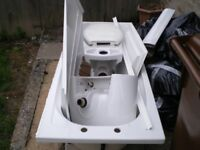 Bathroom Suite in White in good working order, no damage.