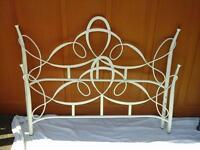 cream coloured metal bed frame