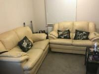 2 leather creamy/yellow two seater sofas