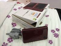Burgundy Nintendo DS XL, includes charger and a bunch of games