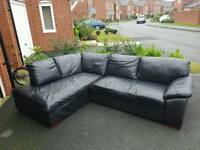 Black corner sofa with arm chair