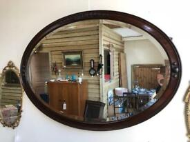 Early 1900s huge oak framed oval mirror by Ray and Miles of Liverpool
