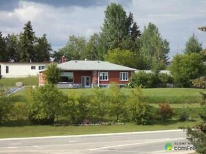 $498,000 - Bungalow for sale in Cochrane