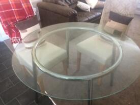 Glass Dining table and 2 x cream chairs - can deliver