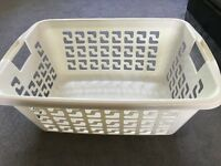 White plastic washing basket in excellent condition
