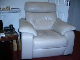 Beige leather electric armchair 2 years with slight set markings.